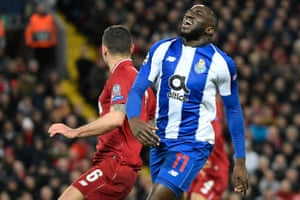 Porto's Moussa Marega (R) reacts after missing another chance