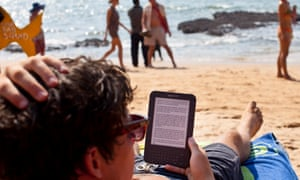 A tourist in Goa reads an Amazon Kindle – the market leader in ebooks.