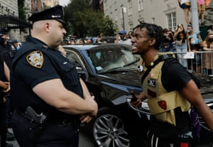 A Black Lives Matter protester confronts police officers outside the Met Gala on Fifth Avenue in New York