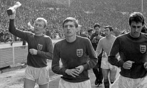 Martin Peters, second left, with Bobby Moore, left, Gordon Banks and Geoff Hurst, right, parading the World Cup around Wembley after England's victory in 1966.