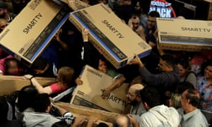 Shoppers in the US compete to buy televisions