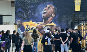 Fans mourn the death of Kobe Bryant at a mural near the Staples Center in Los Angeles.