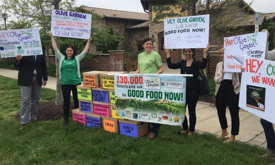 Protesters gather at an Olive Garden in Hyattsville, Maryland, on Thursday as part of a national campaign to force the restaurant chain to change its meat purchasing and labor practices.