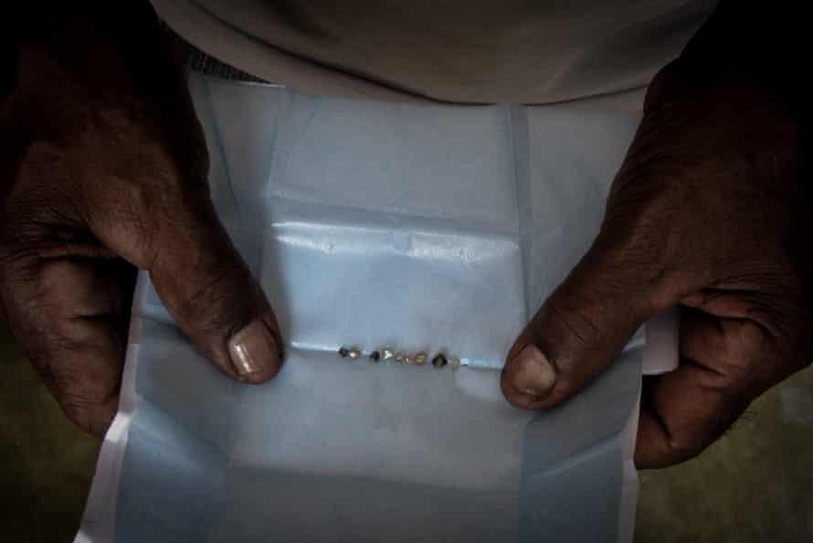 A miner displays the diamonds he has taken from streams in Chapada Diamantina, Bahia State.