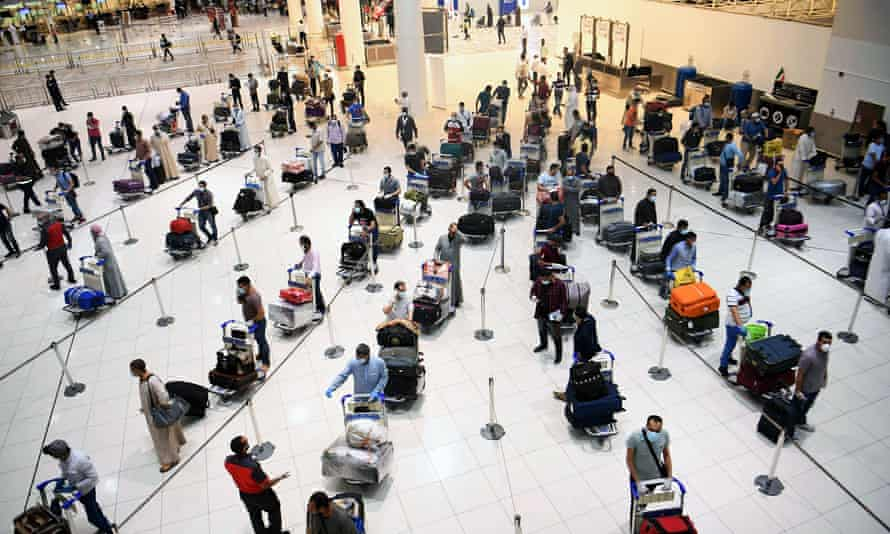 Egyptian citizens queue at Kuwait International Airport before boarding a repatriation flight to Cairo on 5 May.