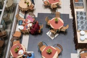 Buddharakkhita takes his meal alone in a Kampala restaurant.