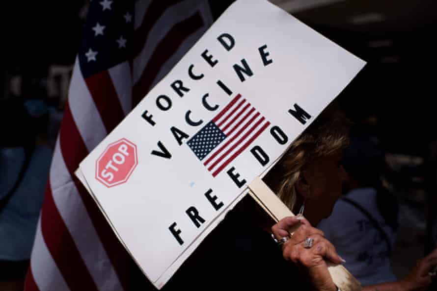 Anti-vaccine protesters hold signs outside of Houston Methodist hospital.
