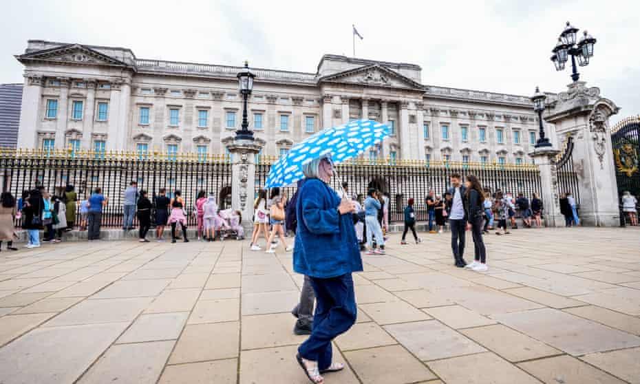 People walk past Buckingham Palace in London on Monday.