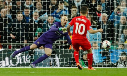 Willy Caballero is about to save Philippe Coutinho's spot-kick