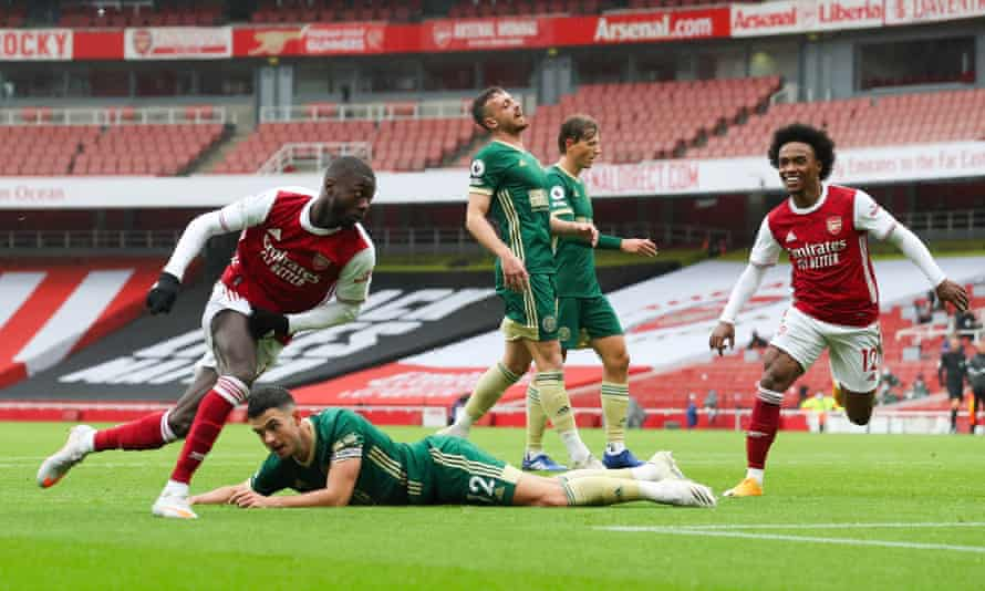 Nicolas Pépé slots home Arsenal's second against Sheffield United in their Premier League match at the Emirates Stadium.