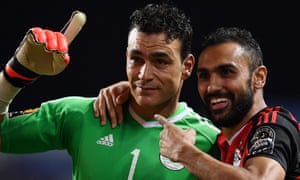 Egypt's goalkeeper Essam El Hadary (left)  and midfielder Ahmed Elmohamady celebrate beating Burkina Faso on penalties to reach the final of the Africa Cup of Nations