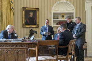 President Donald Trump, accompanied by from second from left, Chief of Staff Reince Priebus, Vice President Mike Pence, National Security Adviser Michael Flynn, Senior Adviser Steve Bannon, and White House press secretary Sean Spicer, speaks on the phone with Russian President Vladimir Putin, in the Oval Office at the White House in Washington. All but Pence have since left their jobs, and Flynn has pleaded guilty to lying to the FBI.