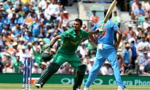 Fakhar Zaman wildly celebrates the century that set up Pakistan's win.