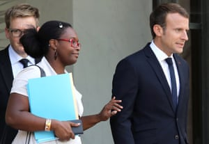 Then public relations adviser of French president Sibeth Ndiaye (L) and French president Emmanuel Macron leave the Elysee palace in Paris in October 2017