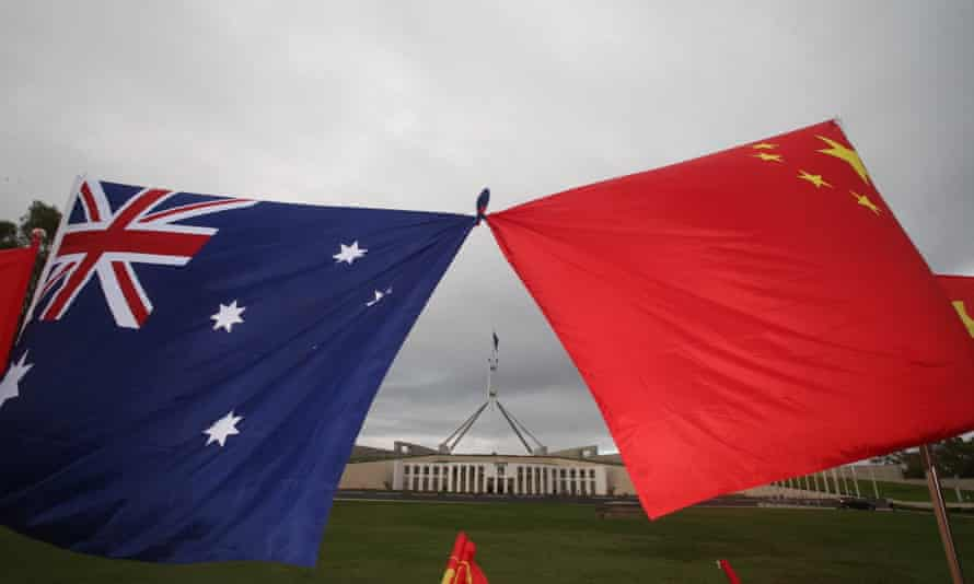 File photo of Australian and Chinese flags in front of Parliament House, Canberra in 2017