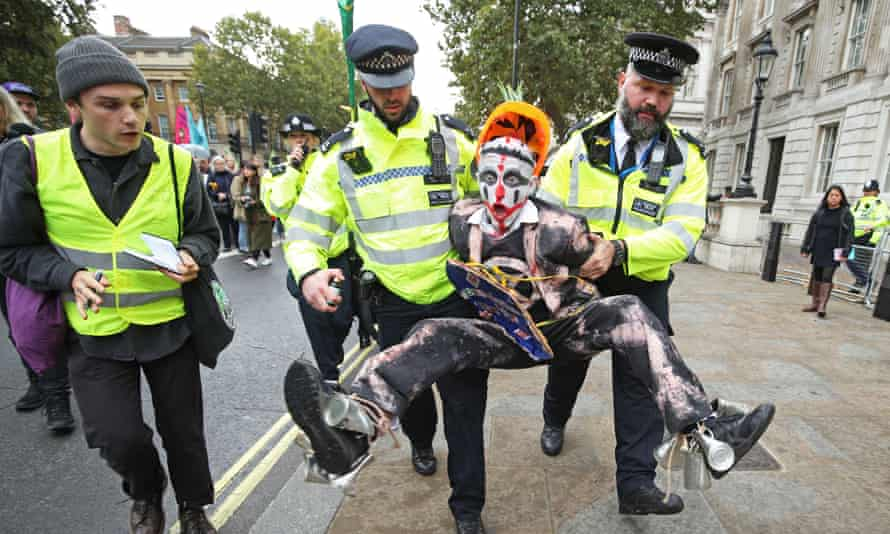 Police holding a protester during an Extinction Rebellion demonstration in central London in October 2019