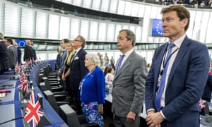 A symbol of dark and light ... members of the Brexit party turn away during the opening of the European parliament.