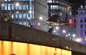 A helicopter lands on London Bridg