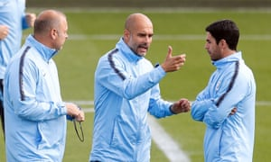 Pep Guardiola discusses tactics with his assistants Rodolfo Borrell (left) and Mikel Arteta during a training sessopm at the City Football Academy.