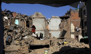 Earthquake victims search for belongings at collapsed house in Sankhu on the outskirts of Kathmandu, 3 May 2015.