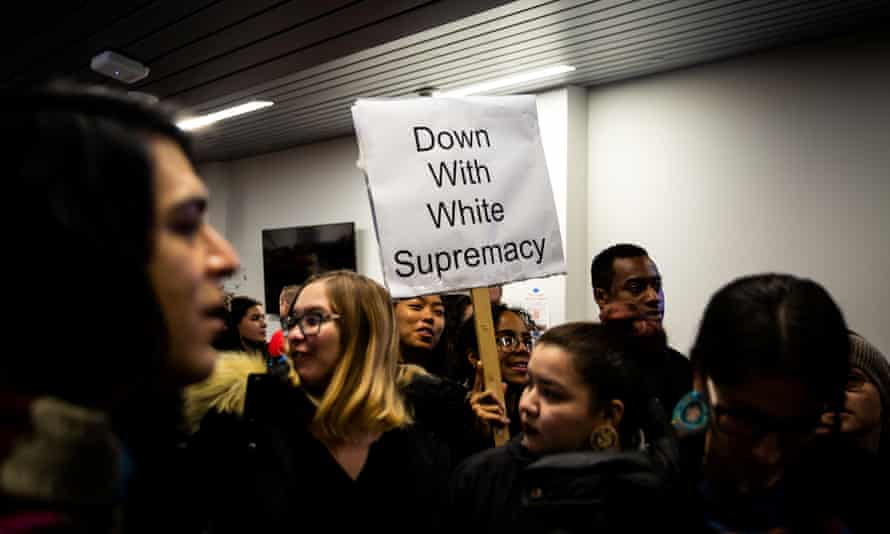Students rally against white supremacy at Syracuse University in New York on 20 November 2019.