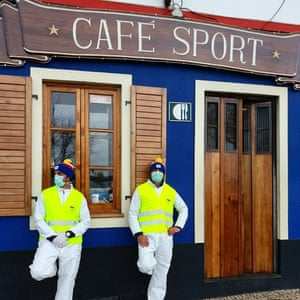 Men wearing masks and high viz jackets outside Peter Cafe Sport, Azores