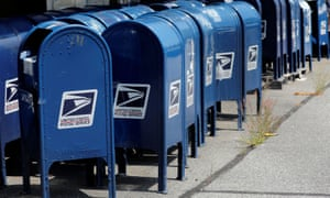United States Postal Service (USPS) mailboxes stored outside a USPS post office facility in the Bronx, New York.