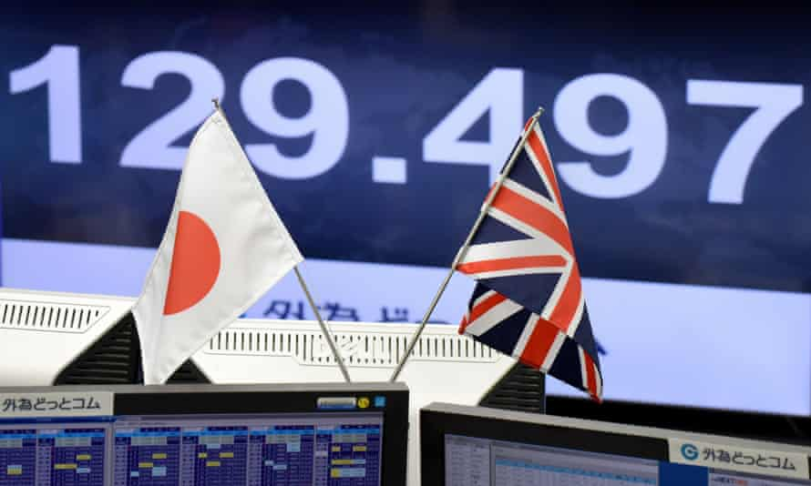 Japanese and British flags in front of computer screen
