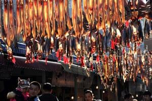 Dried fish hung at a market in Dalian, China