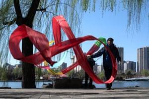 A man draws circles with a ribbon in Yuyuantan park in Beijing, China
