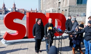 Andrea Nahles (L) and Olaf Scholz of Social Democratic party (SPD) give a press statement in Berlin.