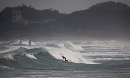 Surfers ride the waves in Fukushima