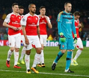 Arsenal's Laurent Koscielny, Olivier Giroud, Theo Walcott, Gabriel Paulista and David Ospina look dejected and shellshocked.