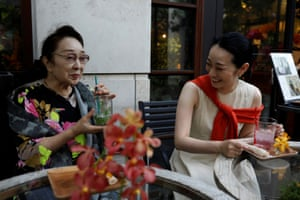 Ikuko and Koiku, who are geisha, wear causal clothes as they chat at a cafe in Tokyo