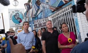 Congresswoman Veronica Escobar (right) and the congressman she succeeded, Beto O'Rourke (left), among mourners in El Paso after the weekend shooting