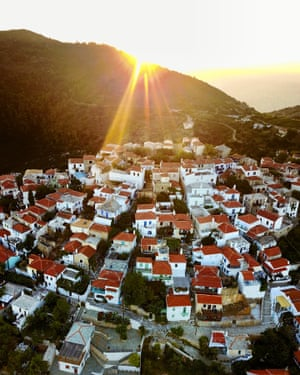Drone image of sunset above a mountain overlooking Alonisos. Alonissos is the most remote island in the Northern Sporades. The island is famous for its vineyards, almonds, figs and olives. But tourism is the main industry.