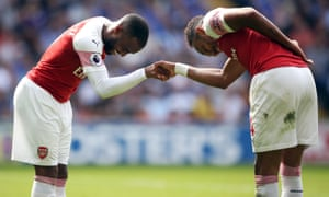 Arsenal's Alexandre Lacazette, left, celebrates with Pierre-Emerick Aubameyang at Cardiff.