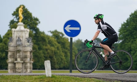 A cyclist in Bushy Park, south-west London, during the Covid-19 crisis