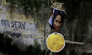 An effigy of Aung San Suu Kyi is placed against a wall during a protest in Kolkata, India