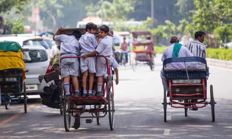 Boys on their way to school in Delhi.