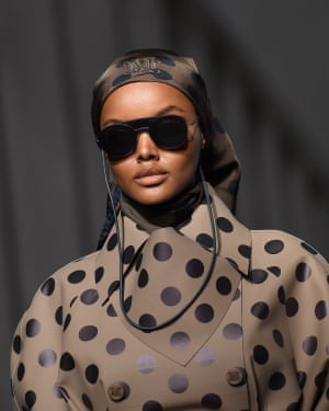 Halima Aden in polka dots and a headscarf.