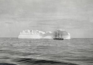 """Dominion Government Steamer """"Arctic"""" in front of an iceberg, at the mouth of Hudson Strait, Nunavut, ca. 1904"""