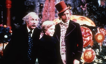 Jack Albertson as Grandpa Joe, Peter Ostrum as Charlie and Gene Wilder as Willy Wonka in the 1971 film based on Charlie and the Chocolate Factory.