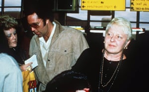A rare sighting of the couple together in 1987. Jones signs autographs for fans as he and Linda arrive in London from Los Angeles