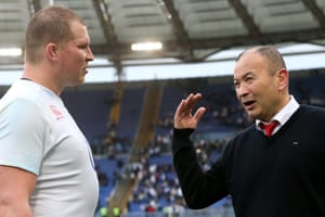 Eddie Jones speaks with England captain Dylan Hartley following their team's 40-9 victory.
