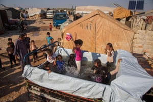 Kali, SyriaChildren play in a makeshift pool installed in a van