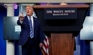 Donald Trump stops a reporter from asking Dr Anthony Fauci a question about use of the drug hydroxychloroquine to treat Covid-19 on 5 April at the White House..