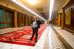 A woman talks on her mobile phone on one of the halls of the Romanian Parliament building, in Bucharest.
