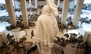 Hundreds of US National Guard troops rest in the US Capitol Visitors Center, with the Statue of Freedom seen at center, on Capitol Hill in Washington, DC, today.At least ten thousand troops of the National Guard will be deployed in Washington by the end of the week, with the possibility of five thousand more, to help secure the Capitol area ahead of more potentially violent unrest in the days leading up to the inauguration of Joe Biden on January 20.