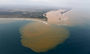 An aerial view of the Rio Doce at an area where the river joins the sea, on the coast of Espírito Santo in Regência village.
